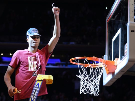South Carolina Gamecocks guard PJ Dozier (15) celebrates after cutting  piece of the net after beating the Florida Gators in the finals of the East Regional of the 2017 NCAA Tournament at Madison Square Garden.