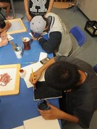 File photo: Two juveniles who take part in the Ventura County Probation Agency's Evening Reporting Center at the Boys & Girls Club's Seventh Street facility in Oxnard work on art projects.