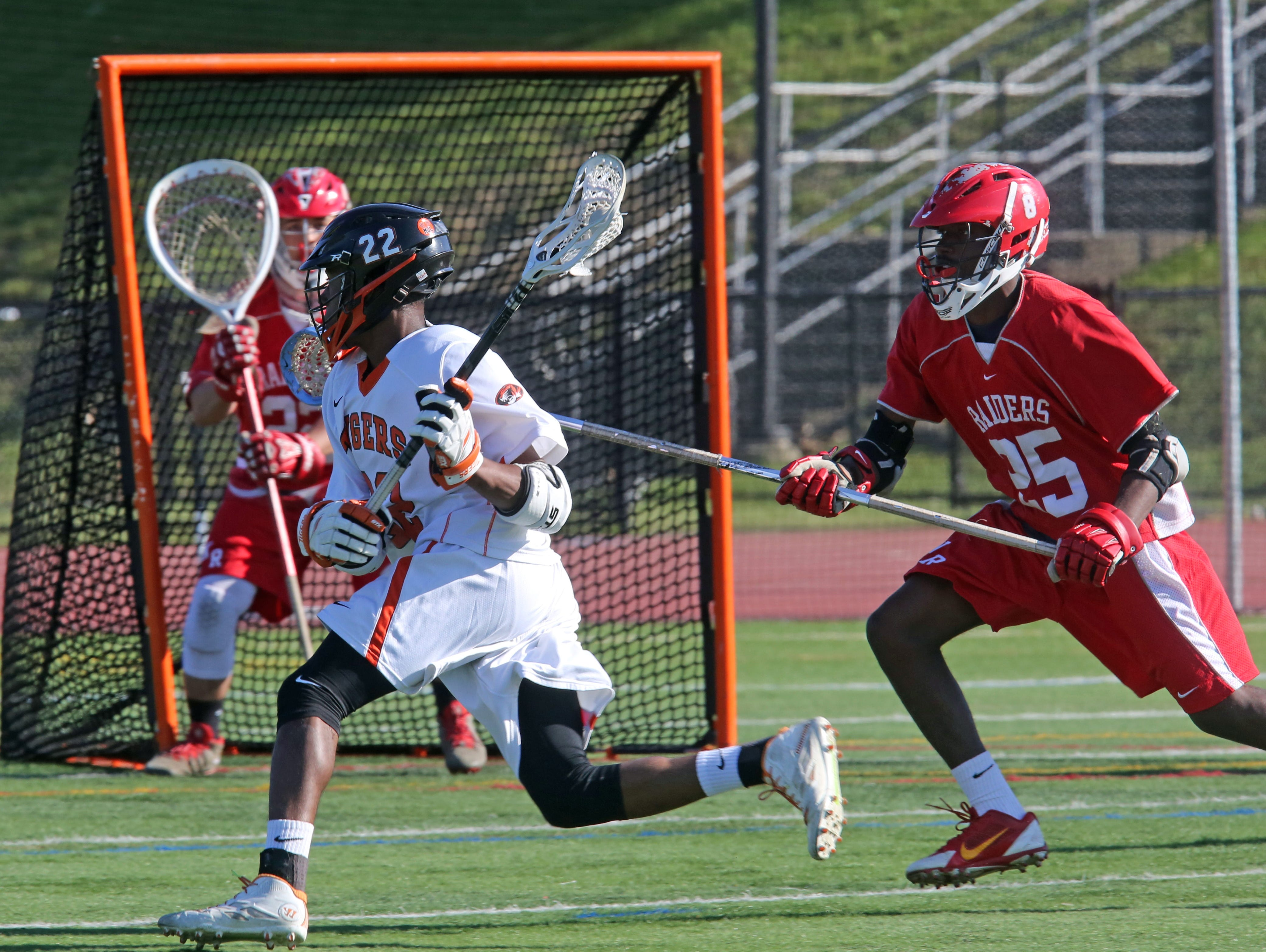 White Plains Miles Tilman (22) scores on North Rockland defense during boys lacrosse Section 1 Class A opening-round game at White Plains High School on May 16, 2016. White Plains defeats North Rockland 13-12.