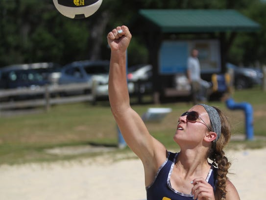 Community Christian's Abbie Post punches a ball over