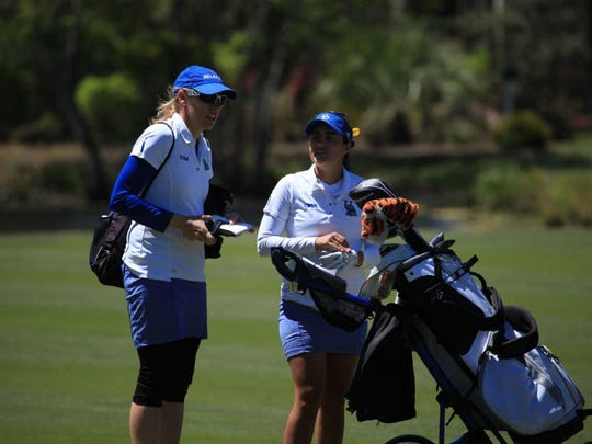 Delaware coach Patty Post talks with UD team member Vitoria Teixeira at the CAA Championships.