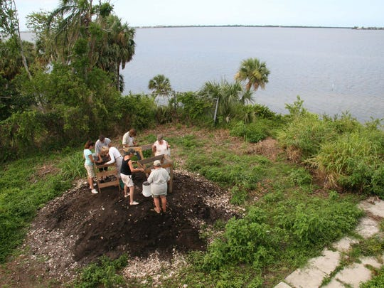 Southeast Florida Archaeological Society volunteers screen materials from the Mount Elizabeth archaeological excavation looking for artifacts in Jensen Beach.