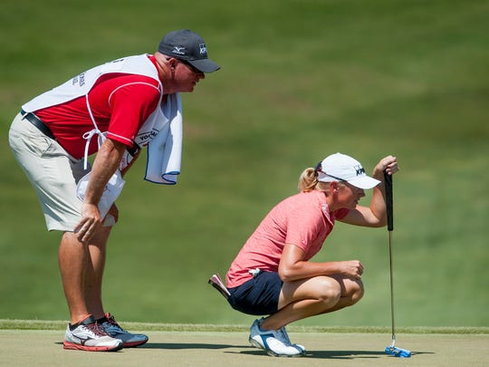Stacy Lewis lines up a putt during round four of the