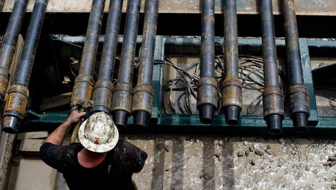Preparing drill pipes in Mannington, W.Va., in 2010.