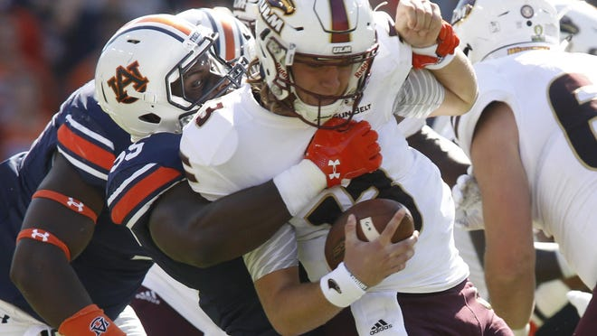 Auburn defensive lineman Carl Lawson (55) sacks Louisiana Monroe quarterback Garrett Smith (13) in an NCAA college football game, Saturday, Oct. 1, 2016 in Auburn, Al.