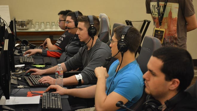 Members of the compLexity Gaming Dota 2 team play during The International Dota 2 Championships in Seattle.