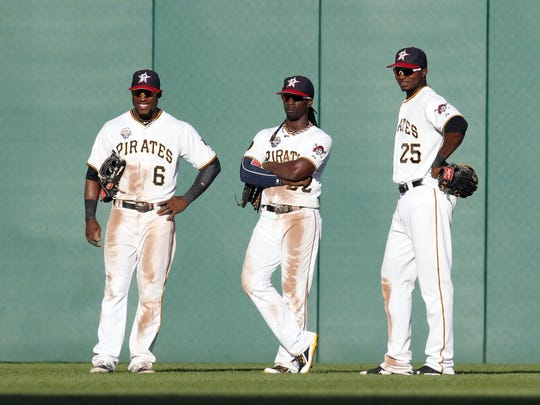 Pittsburgh Pirates outfielders Starling Marte (left) and Andrew McCutchen (middle) and Gregory Polanco (right) wait out a pitching change against the Philadelphia Phillies during the sixth inning at PNC Park, July 4, 2014.