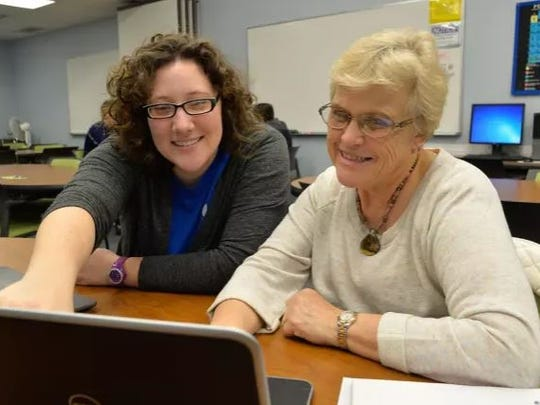 Center for Academic Student Achievement (CASA) tutor Kailin Johnson assists student Phyllis Loeffler with Excel Program. The mission of CASA is to close educational gaps by providing TAMU-CC students with academic and mentoring services.