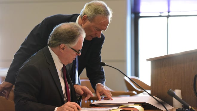 """Standing, Raymond R. Wiss, the defense council for the City of Hackensack and Brian Giblin Sr., the plaintiff council for Charles """"Ken"""" Zisa, look over the agreement while Judge Contillo decided with the defense that former Hackensack Police Chief Zisa should not receive health benefits after Oct. 6."""