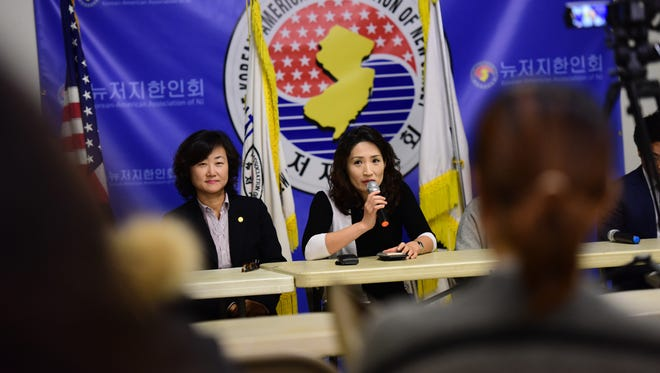 Eunju Hong, vice president of the Korean-American Association of Fort Lee, talks at a press conference in reaction to discriminatory comments made by a Bergen County Academies teacher toward the Korean community.