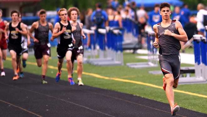 Sheridan's Luke Brown easily outpaces the field in the 1,600 during last year's Dan Adams Invitational. Brown signed to run for Division I Eastern Michigan on Tuesday.