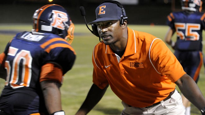 Escambia High head coach Willie Spears congratulates players after a touchdown during the 2012 season.