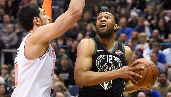 Bucks forward Jabari Parker takes a shot against New York Knicks center Enes Kanter.
