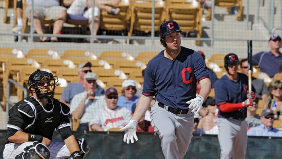 Cleveland Indians' David Cooper watches his double against the Chicago White Sox in the seventh inning of a spring exhibition baseball game Friday, March 14, 2014, in Glendale, Ariz.
