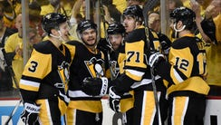 Pittsburgh Penguins right wing Bryan Rust (17) celebrate