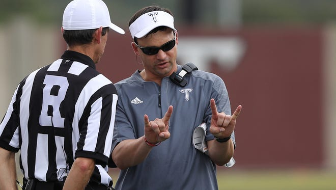 Troy head coach,Neal Brown discusses a play with referees during a game against Georgia State in Troy, Ala. on Saturday, October 15, 2016.