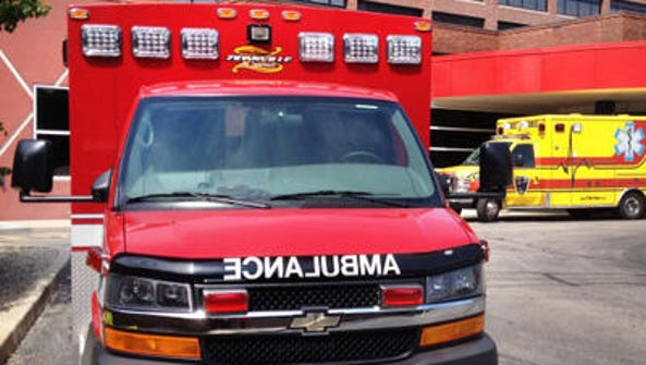 An ambulance sits outside an emergency room.