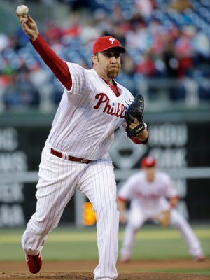 The Phillies' Aaron Harang held the Atlanta Braves to two hits in eight scoreless innings Friday.