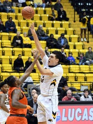 Southern Miss' Tim Rowe shoots for the basket in a