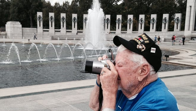 Walter Bauer, a WWII Marine veteran who lives in Kanab, takes photos of the National World War II Memorial in Washington D.C.