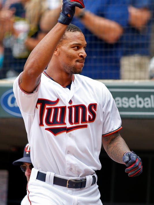 Minnesota Twins' Byron Buxton comes out of the dugout to acknowledge the crowd after hitting a grand slam against the Chicago White Sox in the second inning of a baseball game Sunday, Sept. 4, 2016, in Minneapolis. (AP Photo/Bruce Kluckhohn)