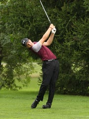 Genoa's Ethan Smith hits his approach shot in the NBC Championship at Green Hills.