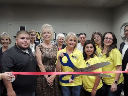 San Angelo Mayor Brenda Gunter and Councilmember Harry Thomas were on hand with the Chamber of Commerce's Concho Cadre to celebrate the grand opening of JW Real Estate, located at 610 S. Abe St., Ste B., with Jerrie Woodford (holding scissors), Gina Birdsong, Paul Yanez, Samantha Tarr, and Landry Scott.