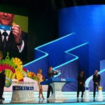 FIFA Secretary General Jerome Valcke holds up the name of USA during the Final Draw.