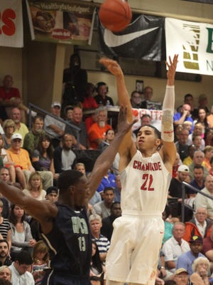 Chaminade's Jayson Tatum attemps a three-pointer over High Point Christian Academy's Edrice Adebayo while competing for the 3rd place position during the City of Palms Calssic on Wednesday night.