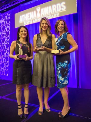 Mi-Ai Parrish (from left), Drena Kusari Berisha and Michelle Just hold their ATHENA Awards during a luncheon at the Westin Kierland Resort & Spa in Scottsdale on Oct. 25, 2017.