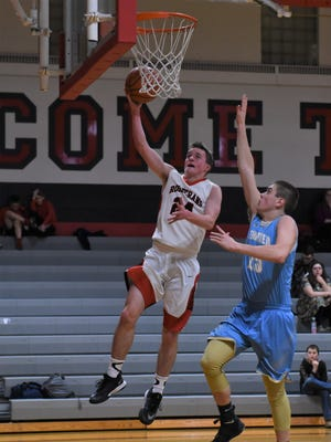 Rosecrans' Weston Nern lays the ball up over Frontier's Logan Brookover. The Bishops won 78-48 on Wednesday.