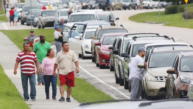 Thousands of people line up Saturday to enter a hurricane shelter at Germain Arena in Estero, Florida. The line is close to two miles long. Residents throughout Florida are seeking last minute shelter in advance of Hurricane Irma.