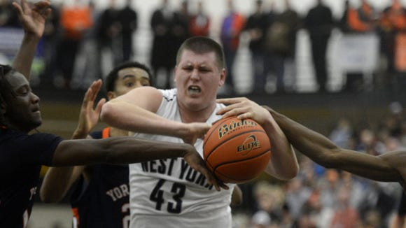 William Penn's Stephen Dickson, left, battles for control over possession of the basketball with West York's Parker Weekly during February's YAIAA semifinals. Both will play in the YAIAA's senior all-star game on March 23 at Northeastern. (GAMETIMEPA.COM -- FILE)
