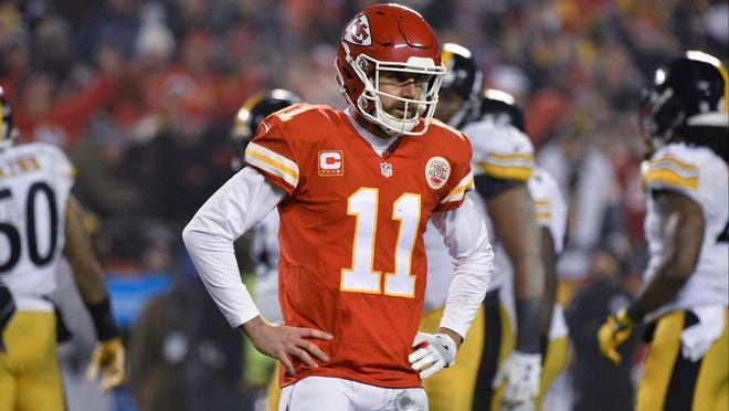 FILE - In this Jan. 15, 2017, file photo, Kansas City Chiefs quarterback Alex Smith (11) walks off the field during the first half of the team's NFL divisional playoff football game against the Pittsburgh Steelers in Kansas City, Mo. The Chiefs have won two playoff games at home in their entire history, even though Arrowhead Stadium boasts one of the biggest homefield advantages in the game. And under coach Andy Reid, they are winless at home and 1-5 overall in the postseason.