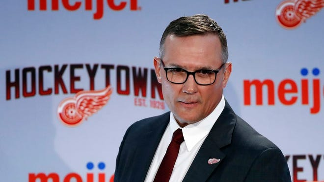 From April 19, 2019, Steve Yzerman walks into the news conference where he was introduced as the new executive vice president and general manager of the Detroit Red Wings NHL hockey club in Detroit. The Red Wings could actually benefit from an adjusted draft lottery that gives him better odds at the top pick, likely Alexis Lafreniere.