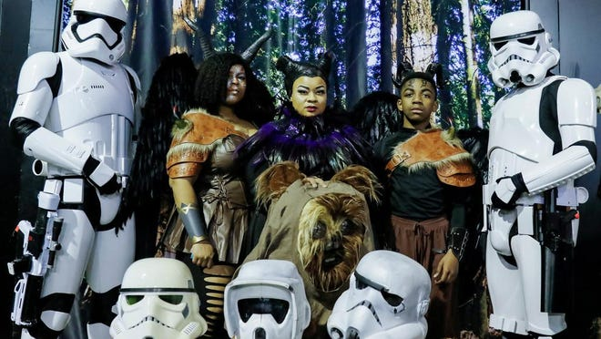 Diamond Layne, center, from Oakland as Maleficent with her children Ananda Brooks, left, 20, and Ahmed Joseph, right, 12, pose with Stormtroopers from the 501st Legion during StocktonCon Winter at Stockton Arena on Jan. 19. Next month's StocktonCon Summer has been canceled due to the COVID-19 pandemic.