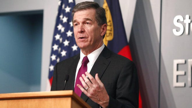 Gov. Roy Cooper answers a question during a briefing at the Emergency Operations Center in Raleigh, N.C., Wednesday, July 1, 2020.