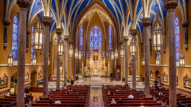 About 50 people spread out among the pews during the first public Mass at St. Mary's Cathedral on Sunday, June 21, 2020 since the coronavirus-related suspension of regular Mass after March 14.