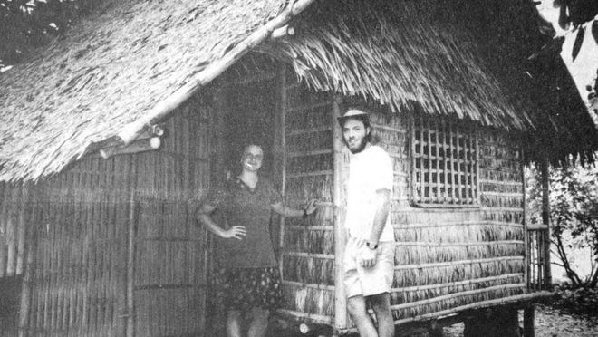 RFHS 1990 graduate Nathan Leeman (right) displayed the grass and bamboo hut he lived in while serving as a Peace Corps volunteer in the Philippines, as seen in this photo that first appeared in the July 31, 1995 Redwood Gazette.