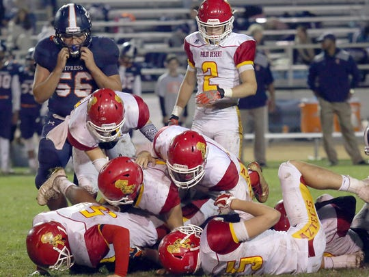 Palm Desert's defense make a tackle against Cypress