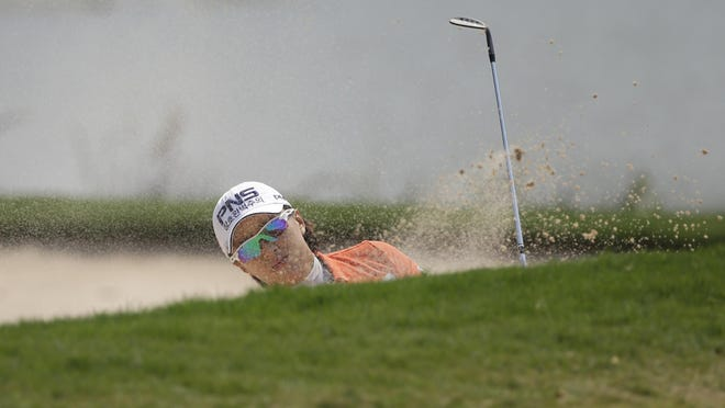 Amy Yang of South Korea hits the ball from the bunker on the 8th hole during the final round of the LPGA Thailand golf tournament in Pattaya, southern Thailand, Sunday.