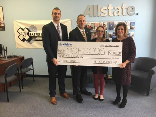 Allstate agent Barry Brikowski (second from left) and