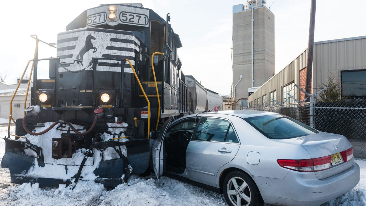 A car slide under the front of a non-moving train at the intersection of Heede Rd and East Ave on Monday, January 8.