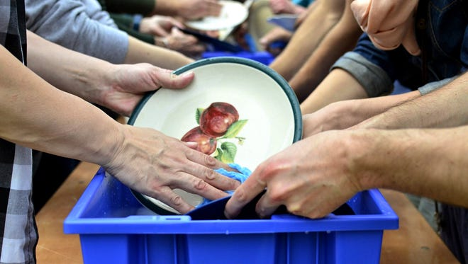 More than 300 people gathered to wash dishes simultaneously in Hardwick's attempt to break a world record while encouraging environmental sustainability on May 27, 2017.