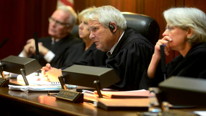 Chief Justice Paul Reiber, center, listens to an oral argument at the Vermont Supreme Court in Montpelier on June 7, 2017.