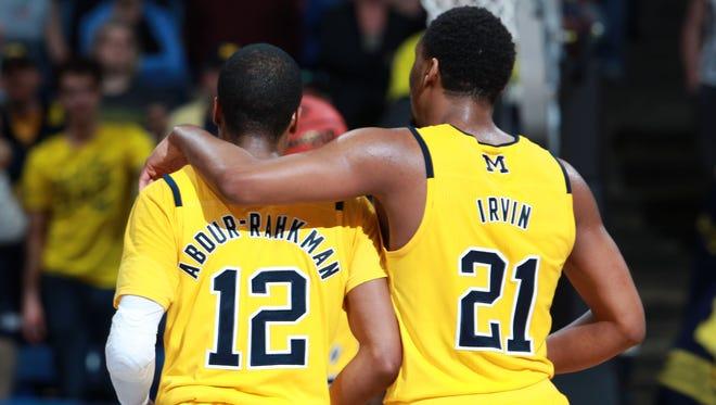 Mar 16, 2016; Dayton, OH, USA; Michigan Wolverines guard Muhammad-Ali Abdur-Rahkman (12) and guard Zak Irvin (21).
