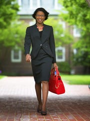 Tia Hargrove's coporate look: Tahari skirt suit in charcoal with light gray pinstripes, Jones New York black knit tank top and Andrew Geller gray fabric and black patent leather peep toe pumps.