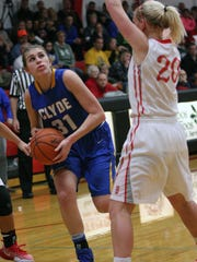 Clyde's Bree Dowling looks for room Tuesday as Bellevue's Lauren Turner defends.