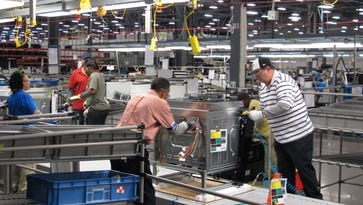 Factories expanded at much slower pace in January