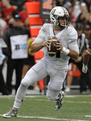 Purdue quarterback David Blough looks for a receiver